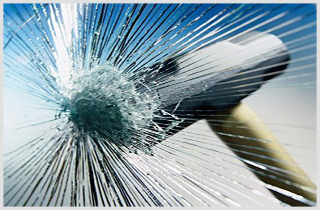 Antishatter-window-film-forced-breaking-in